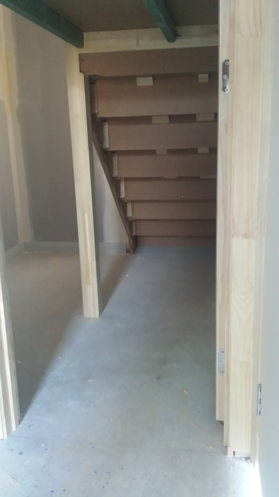 Storage space under the stairs.